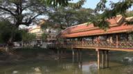 People walk on bridge over Siem Reap River