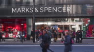 People walk past a branch of Marks and Spencer in Oxford Street on November 7 2016 in London England British high street retailer Marks and Spencer...