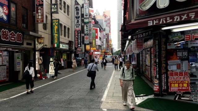 People walk past shops in Shinjuku on September 06 2017 in Tokyo Japan