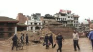 People walk past the rubble of destroyed Durbar Square in Kathmandu / A major earthquake hit Kathmandu midday on Saturday April 25th and was followed...