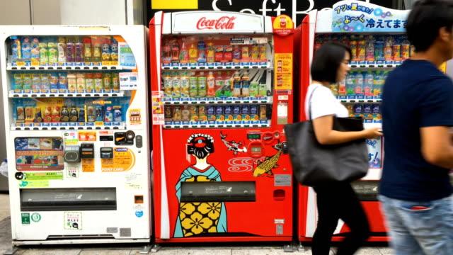 People walk past vending machines in Shinjuku on September 06 2017 in Tokyo Japan