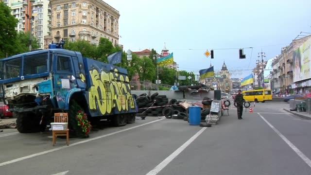 People walk through Maidan in Kiev Ukraine days before presidential election