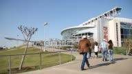 KIAH People Walk Up Ramp Outside the NRG Stadium During the Day in Houston on March 3 2016