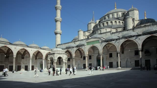 WS People walking across Blue Mosque courtyard, Istanbul, Turkey
