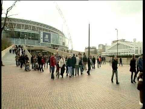 People walking along Wembley Way after leaving Wembley Stadium London