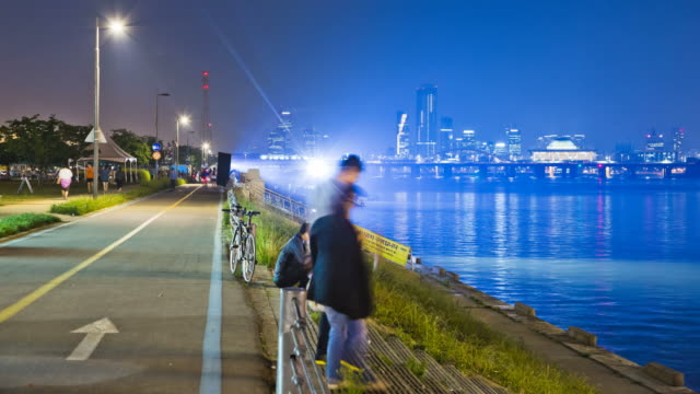 WS T/L People walking and cycling in Riverside Hangang Park at night / Seoul, South Korea