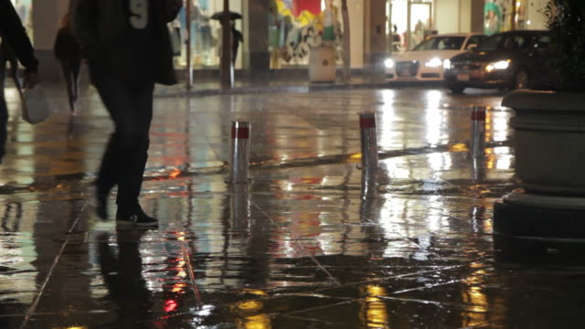 People Walking And Running In The Rain On The Street At ...