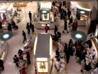 People walking around make-up counters in London department store