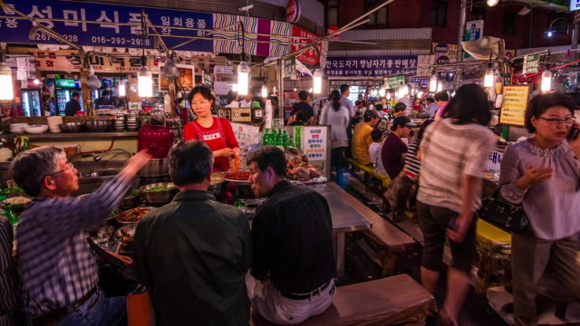 People Walking around the Gwangjang Market(the oldest and largest traditional markets in Korea)