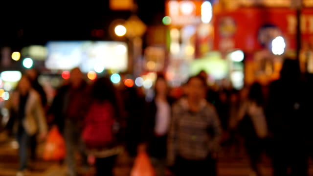 People Walking at Night in China Town at Queens, New York