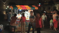 MS People walking by food stand at night, Merida, Yucatan, Mexico