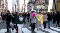 People walking down 5th Avenue adorning festive costumes at the 2015 Easter Parade in Midtown Manhattan