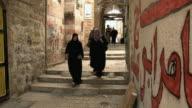 MS PAN People walking down steps on Old Town alley / Jerusalem, Israel