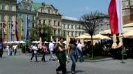 People walking in Rynek Glowny (main square), Poland, Krakow