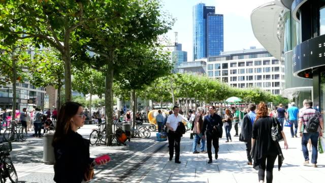 People Walking In Shopping Street (4K/UHD to HD)