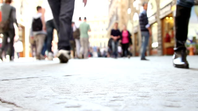 People walking in street - Surface level shot