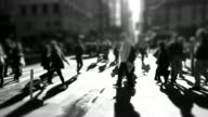 people walking in the city. silhouette of pedestrians. crowded urban street.