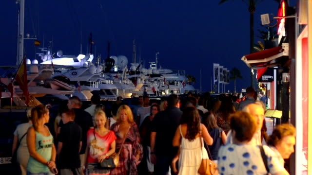 People walking in the commercial area of Puerto Banus, Malaga