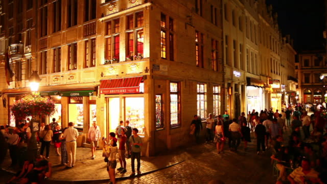 People Walking in the Old Town of Brussels at Night