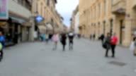 People walking in the old town of Pisa.