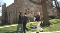 MS People walking on campus paths, three students sitting on lawn, Bethlehem, Pennsylvania, USA