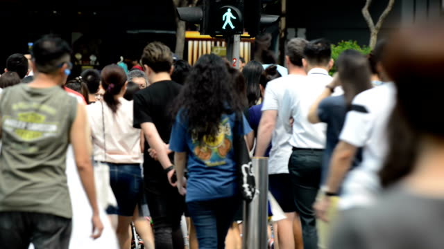 People Walking on Crowded City Street of Singapore