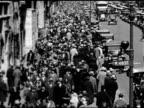 People walking on crowded full sidewalk at West 46th Street sign FG WS People in coats walking wide sidewalk w/ several men wearing tophats spats...
