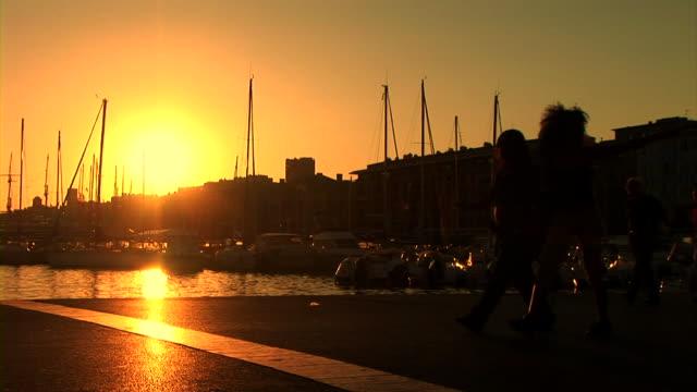 HD: People Walking On Marine Promenade