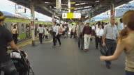 WS, People walking on railway platform, Tokyo, Japan