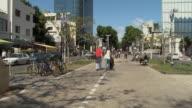 WS People walking on Rothschild Boulevard / Tel Aviv, Israel