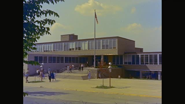 WS People walking outside of Birmingham High School / Birmingham, Michigan, United States