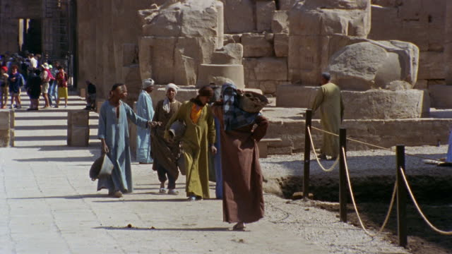 WS People walking past pit at Luxor Temple construction site/ Luxor, Egypt