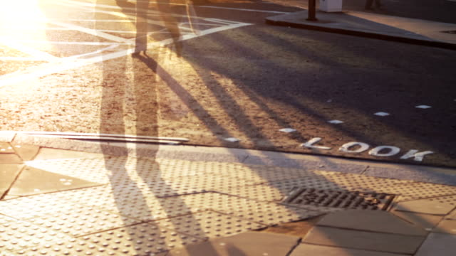 People walking, pedestrian crossing, seamless loop. HD, NTSC, PAL