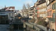 WS People walking through bridge over river / Strasbourg, Alsace, France