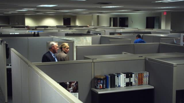 WS HA People walking through maze of cubicles, Dallas, Texas, USA