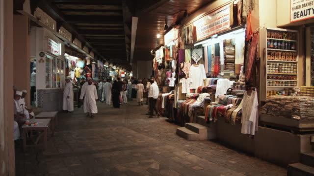 WS People walking through Mutrah souk, Muscat, Oman
