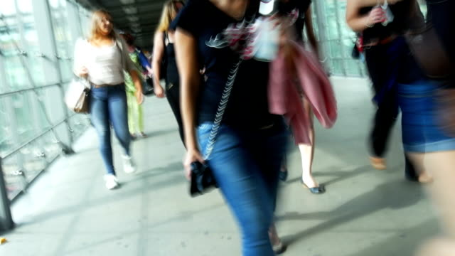 T/L POV People Walking Through Station