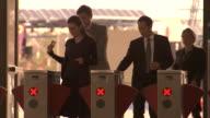 CU, TU, People walking through ticket barriers at Olympic Park railway station, Sydney, Australia