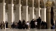 People walking through Umayyad Mosque (Great Mosque of Damascus), Damascus, Syria