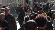 People Walking Under the Noon Sunlight on New York Manhattan Street
