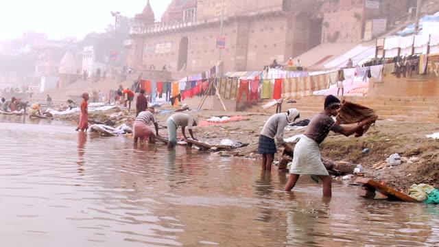 WS People washing clothes in bank of Ganges River / Varanasi, Uttar Pradesh, India