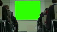 People Watching Screen. Green screen.