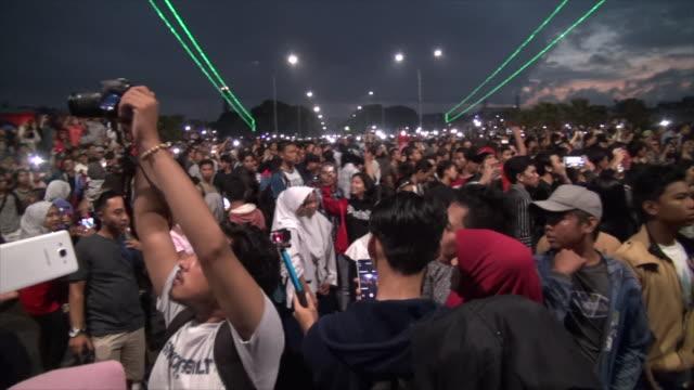 People watching the eclipse on The Ampera Bridge in Sumatra.