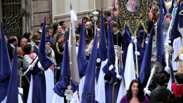 People watching the Hooded Nazarenos parade during the celebration of Semana Santa a Holy week in Malaga Spain, Europe