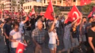 People wave Turkish flags and chant antiterror slogans during a protest against terrorist attacks on September 9 2015 in Izmir Turkey Footage by...