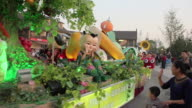 WS People wearing colorful costumes and parade float/xian,shaanxi,China