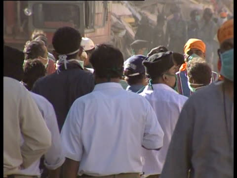 People wearing masks to reduce the spread of disease following the Gujarat earthquake in 2001