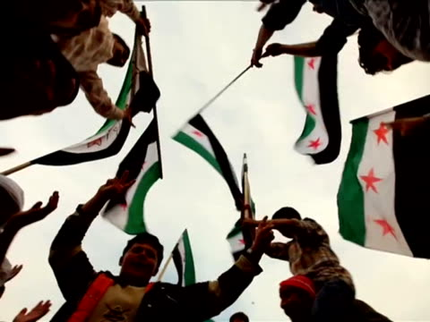 People with flags of the Syrian Republic