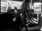 B/W 1918 people with masks to prevent Spanish flu flags marching in Liberty Loan Parade / newsreel