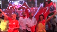 People with some wellknown Turkish artists and singers gather to protest July 15 failed military coup attempt in tourist attraction district Bodrum...